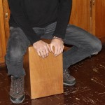 Landon plays the cajon.