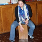 Becca plays the cajon.