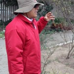A tour guide shows the type of plants and trees raised at Huaca Pucllana.