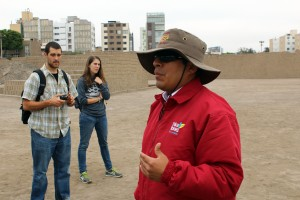 Rudy and Lauren listen as a tour guide explains the history of Huaca Pucllana.
