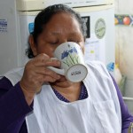 Alicia Taipe Tello samples some herbal tea.