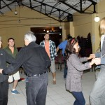 SST co-directors Judy Weaver and Richard Aguirre take a turn on the dance floor with Landon and Maria, a Cuzco dancer.
