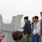 GC students examine an outdoor sculpture by Victor Delfin.