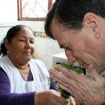 Goshen College Director of International Education Tom Meyers inhales the fragrance of an Andean herb.