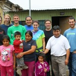 Becca, Landon, Alan, Jacob, Lauren, Joshua and Rudy pause for a photo with Corpusa Villavicencio Zela, three of her four children, and her brother, Willy Villavicencio, Goshen College's service coordinator in Peru.