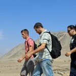 Alan, Rudy and Jacob descend a vista point at Caral.
