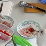 Students mix fish and chili peppers for ceviche.