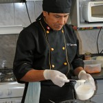 Nicolás Ferrer Quispe adds his special sauce for the ceviche.