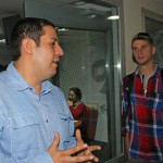 Alan (right) listens to Daniel Vega Baldarrago, assistant business manager of RPP's entertainment unit.