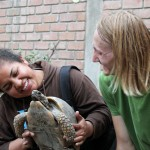 Landon and a Peruvian friend greet a turtle.