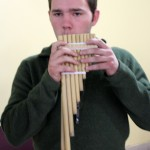 Joshua tries out the pan flute.