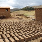 Adobe is an economical building material. The bricks harden by drying in the sun.