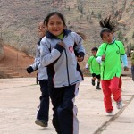 Second-graders run at Fe y Alegria.