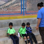 Jacob counsels boys at Fe y Alegria.