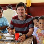 Even while on his lunch break at INABIF, Josh is surrounded by children who want his attention. Josh patiently obliges.