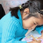 Wanda, Rudy's host sister, focuses on her assignment at the Vidas preschool.
