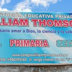 The exterior sign at Institución Educativa Privada William Thomson, a primary school in Ayacucho, notes its partnership with Goshen College.