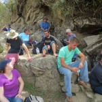 Students rest after descending the summit of Wayna Picchu.