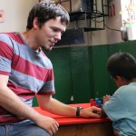 Joshua fully engaged in his service assignment – helping children.