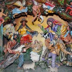 Detail from the retablo, this section depicting the birth of Jesus Christ.