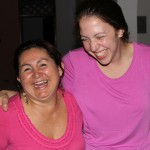 One photo too many causes Becca and her host mother, Patricia Del Aguila Gerbi, to break into laughter.