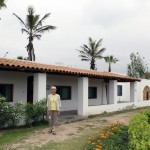 Judy pauses in front of the Villa Margarita housing unit at Kawai, a Christian campground on a beach south of Lima.