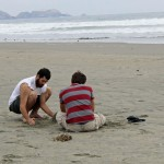 Rudy and Joshua start a sand sculpture at Kawai.