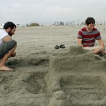 Rudy and Joshua apply the finishing touches on their sand sculpture.