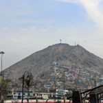 A view of the Cerro San Cristóbal, the steep hill that overlooks central Lima. It is topped by a giant cross.