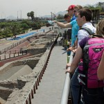 Students check out an original section of the defensive wall that once surrounded the central city and was built between 1684 and 1687.