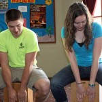 Caleb and April try the cajón.