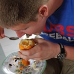 Dean enjoys the tasty seeds and gelatinous pulp of a granadilla.