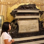 A tour guide in front of the tomb of Francisco Pizarro, a Spanish conquistador and the founder of Lima. The metal box on the left once contained Pizarro's skull.