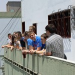 Students take a break on the balcony of Casa Goshen.