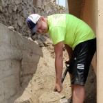 Dean helped clear sand that was pressing in and damaging one side of the church building.