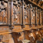 Beautiful wood-carved choir stalls beside the main altar.