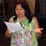 Betty Lozano Cahuana reads about her new host son, Derek.