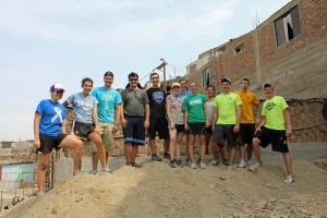 The group posed for a final photo on the mound of dirt they had made.