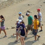Students walk past the amphitheater at Caral.