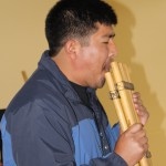 Mauro Claros plays two pan flutes.