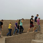 Students climb toward a second plaza of the main pyramid.