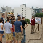 Students learn about tombs found at Huaca Pucllana..