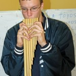 Thomas tries out a pan flute.