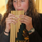 April plays a pan flute.