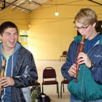 Caleb and Jackson enjoy trying out the instruments.
