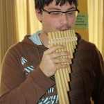 Jonathan tries out a pan flute.