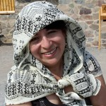 Lima Study Coordinator Celia Vasquez uses a scarf as a protection from the sun at Caral.