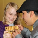 "Aimee gets a pan flute lesson from Americo ""Amaru"" Mejia."