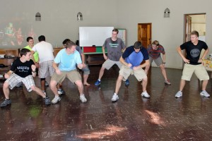 The men show their enthusiasm for dancing.