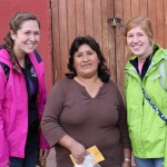 Malaina and Natalie with their host mother in Lucre.